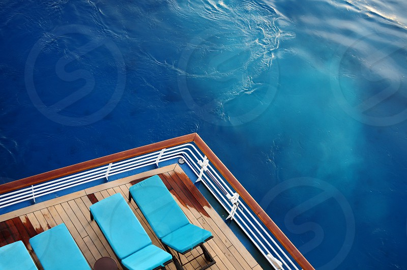 Cruise deck lounge chairs. Blue Caribbean water. photo