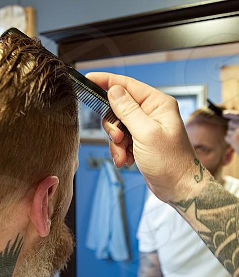 Portrait; self; mirror; comb; wet hair; tattoos photo