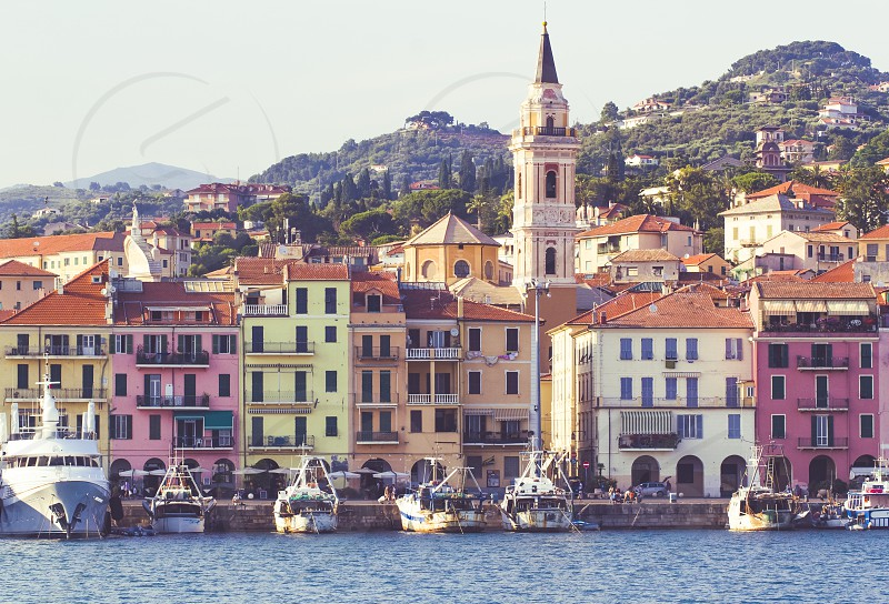 Italy Liguria ancient port of the province of Imperia Oneglia with fishing boats and colorful houses photo