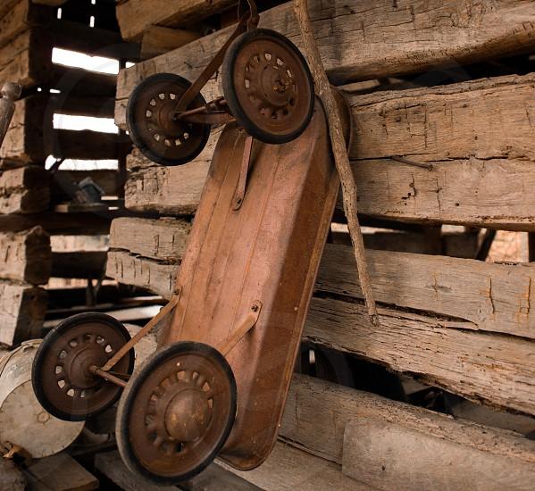 Log cabin old toys wagon photo