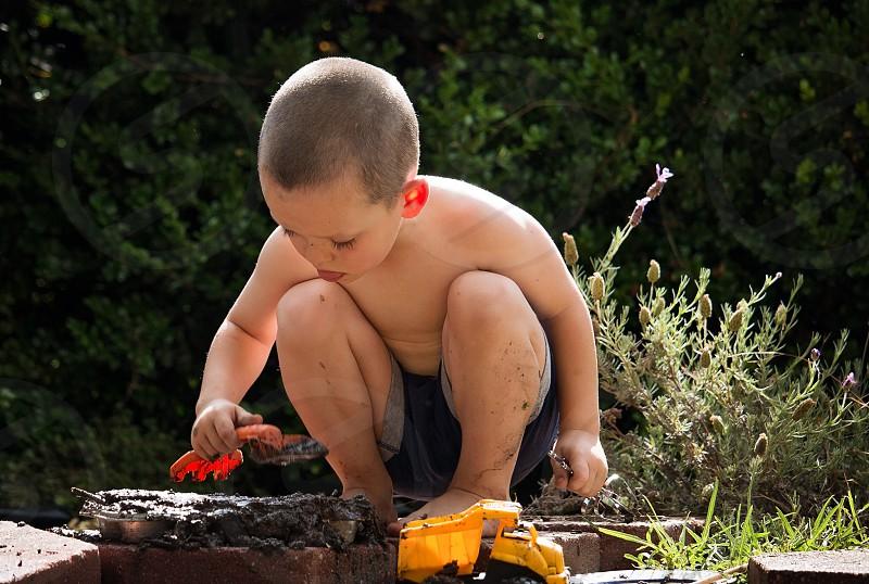 Boy mud outside play summer  photo