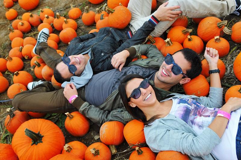 friends having a good time at a farm halloween pumpkin photo
