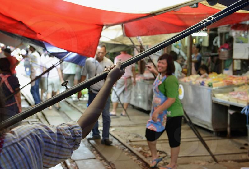 the Maeklong Railway Markt at the Maeklong railway station  near the city of Bangkok in Thailand in Suedostasien. photo