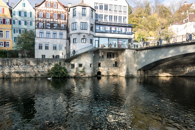 Germany Tubingen city in Autumn view from park on the river bridge and historic buildings photo