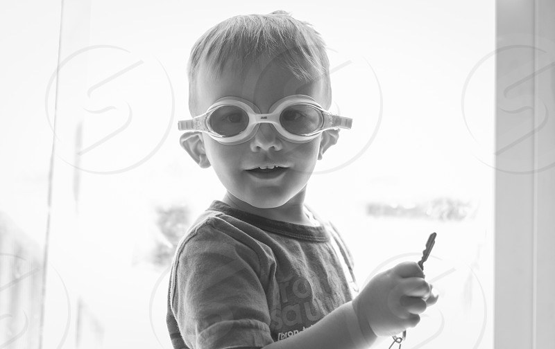 Toddler boy wearing goggles has his key ready to go! photo