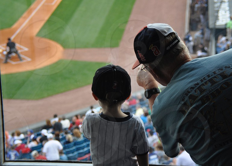 grandparents and grandkids - teaching the sport of baseball photo