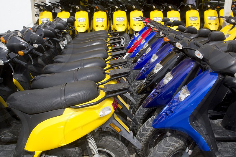 bikes motorbikes motorcycles rows in a renting shop photo