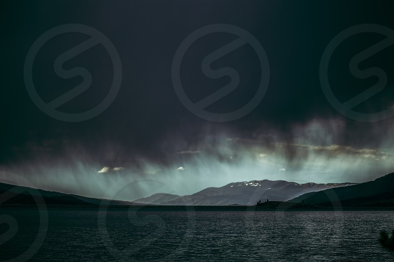 Weather storm rain storm cloud mountains lake moody weather dark scenic clouds grey photo