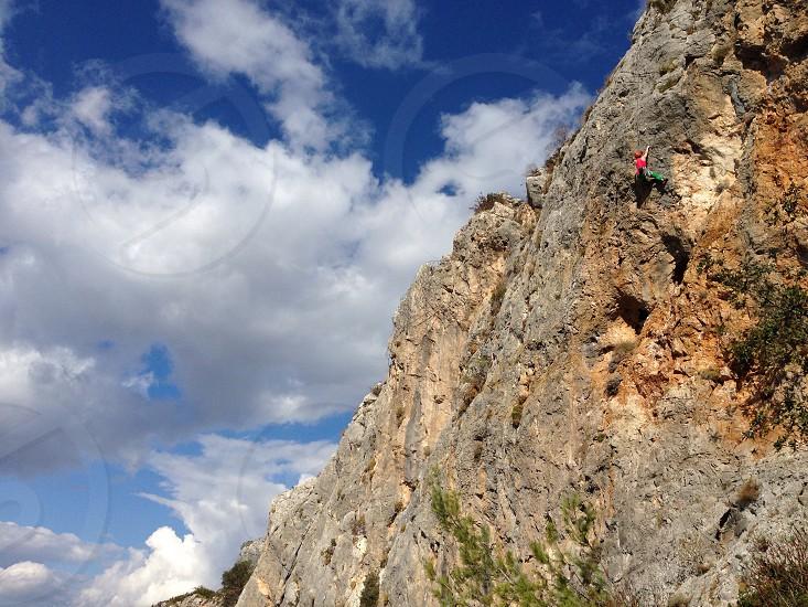 Climber sport climbing rock limestone Sardinia heights  photo