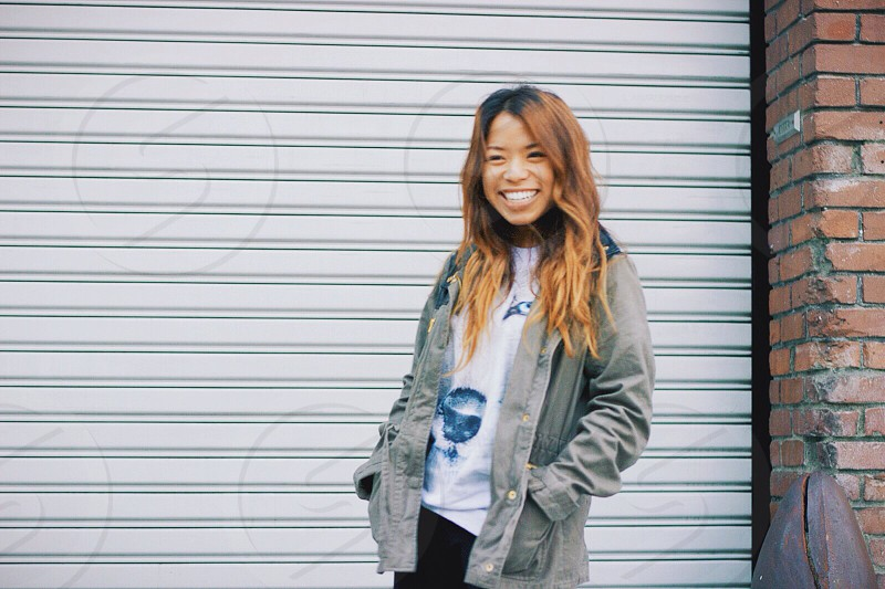 woman in grey jacket smiling photo