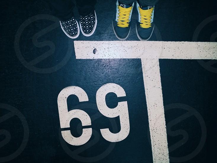 VSCO A2 preset feet sneakers parking lot asphalt photo