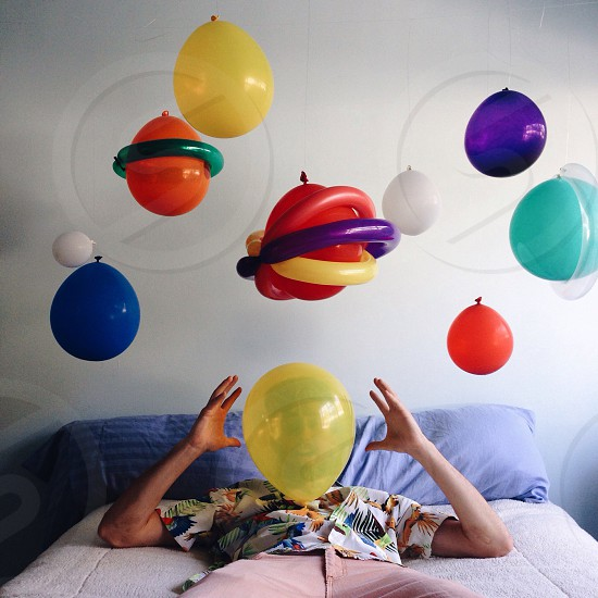 assorted color helium balloons inside room photo