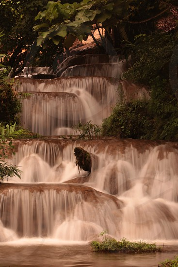 a waterfall in the Tropical Forest near the Village of Fang north of the city of chiang mai in the north of Thailand in Southeastasia.  photo