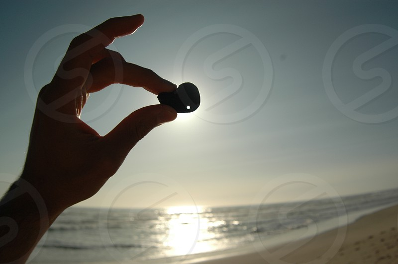 happiness luck sunset sea ocean beach stone hand fingers life love hole photo
