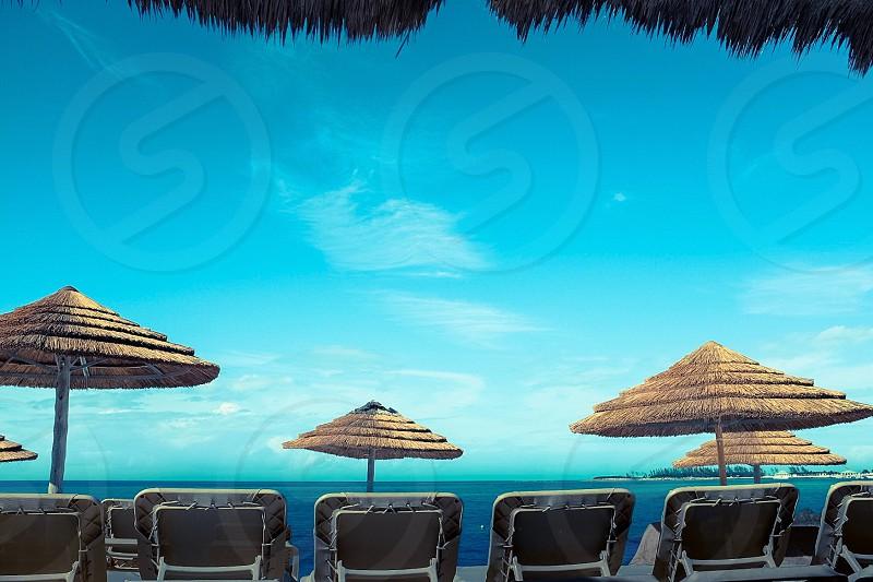 Beach vacation Bahamas Caribbean umbrellas photo
