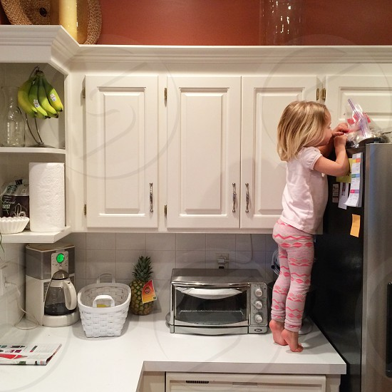 Someone found the candy on top of the fridge. photo