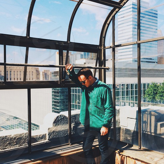 man in green jacket photo