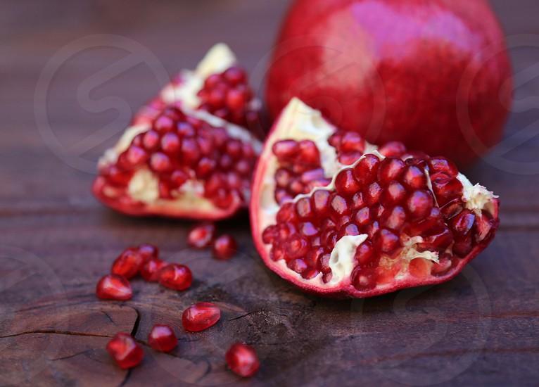 Pomegranates on Wooden Table photo
