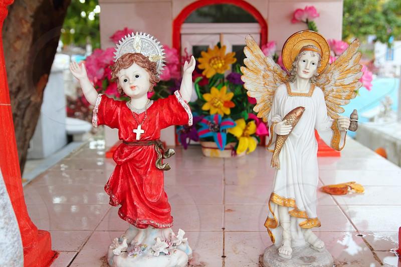 Caribbean cemetery catholic angel saints figures colorful Mexico photo