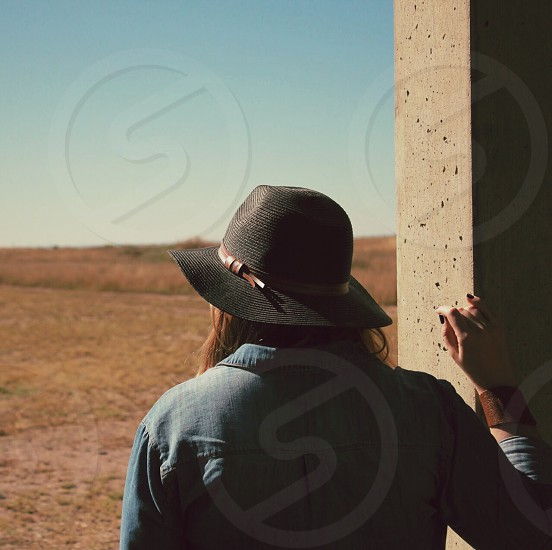 woman in blue denim jacket and black hat photo
