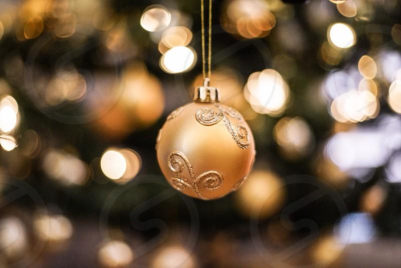 Christmas bauble gold bokeh photo