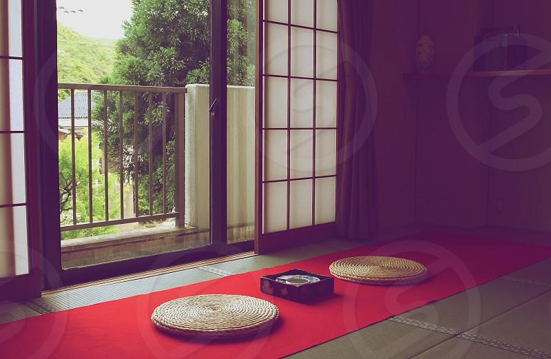 woven round mats on floor photo