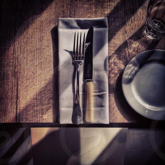 Place setting restaurant cutlery napkin table sunlight photo