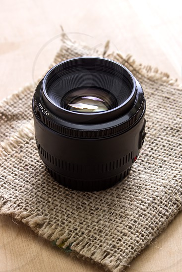 camera lens on the wooden table photo