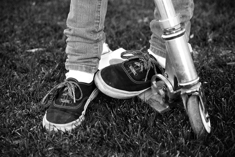 Little girls scooter and sneakers photo