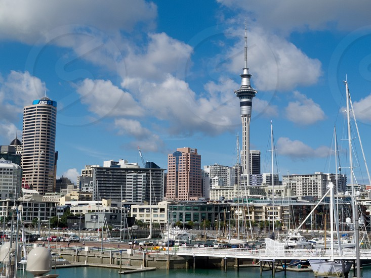 AUCKLAND NZ APR 16 2012: Skyline of Auckland Central Business District with Sky Tower seen from Viaduct Harbor on Apr 16 2012 in Auckland New Zealand photo