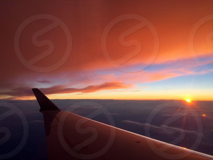 Plane wing at sunset photo