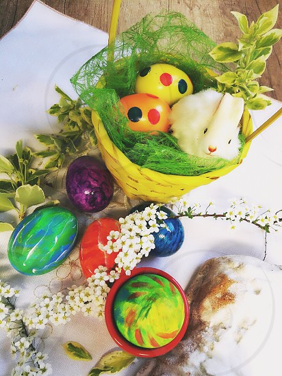 happy Easter. traditional painted eggs bunny basket all happy bright colors photo