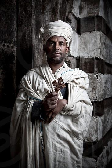 Priest in a rock hewn church lalibela Ethiopia. photo