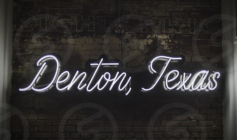 A neon sign in Denton TX. photo
