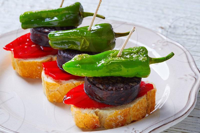 pinchos Burgos morcilla with padron pepper tapas pintxos from Spain food photo