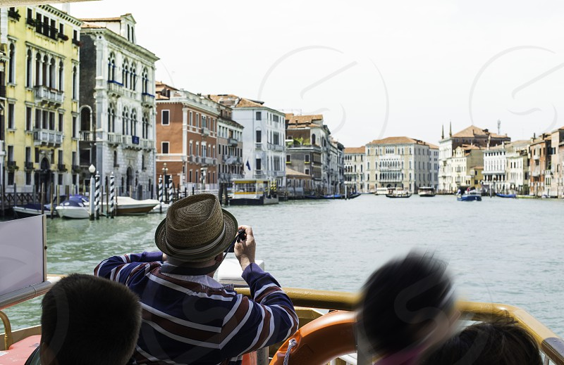 Ancient buildings and boats in the channel in Venice. photo