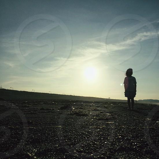 woman on black sand photo