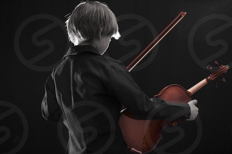 kid with violin enjoying music photo