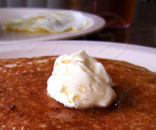 Breakfast butter on pancake photo