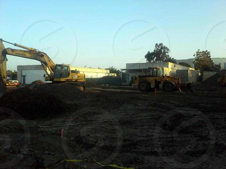 worksite with excavator and bulldozer photo