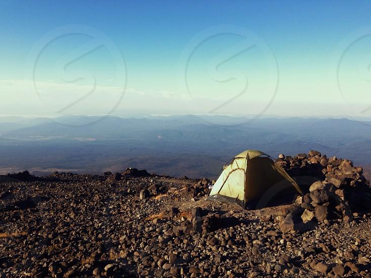 yellow flint tent on mountain photo