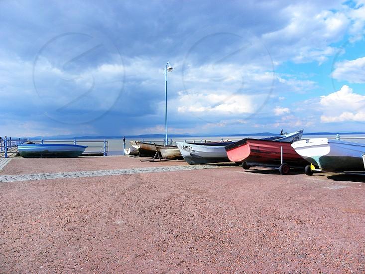 UK. ENGLAND. MORECAMBE. Boat hauled up on the promenade                               photo