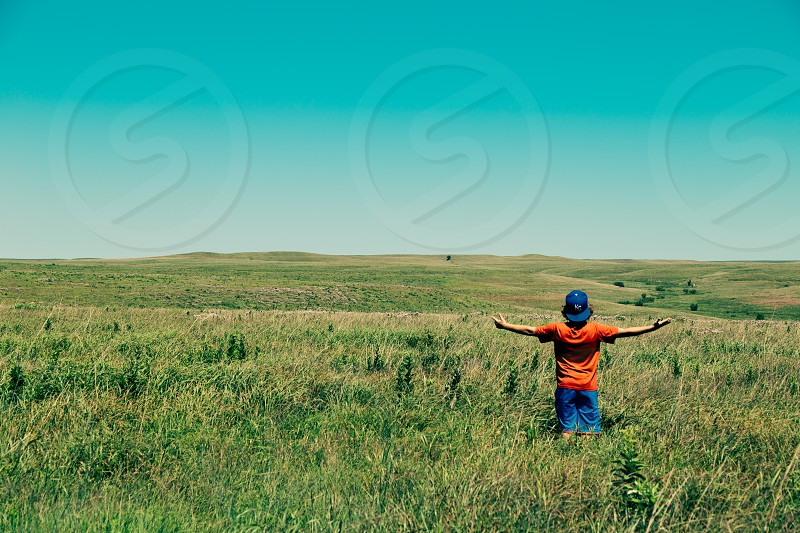 person standing in field photo