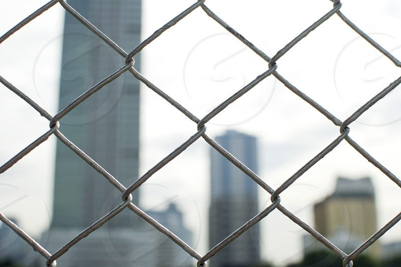 A metal fence in urban area photo