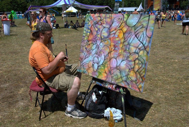 Guy painting at a festival photo