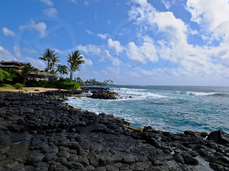 Kauai South Shore Hawaii Island Tropical ocean rocks blue clouds trees palm waves photo