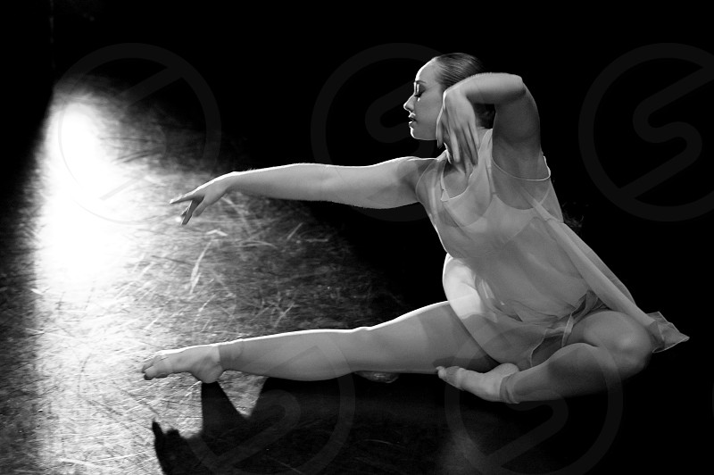 Dancer on stage black and white. photo