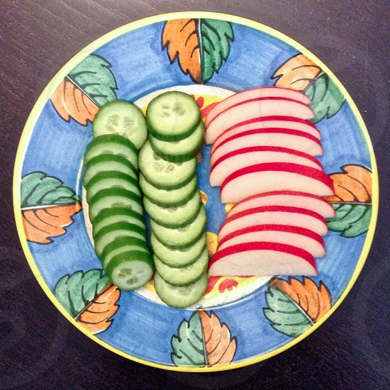 Plate of apples and cucumbers  photo