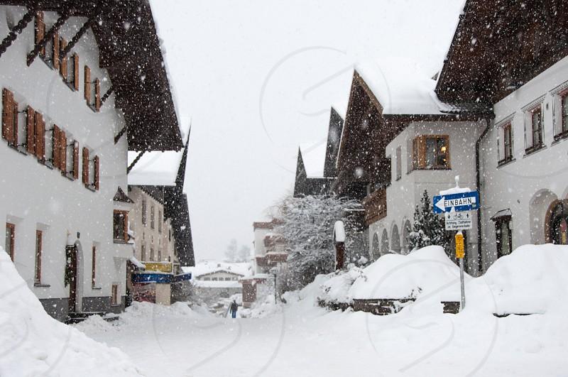 Heavy snow falling in a beautiful ski resport in the Tirol Austria photo