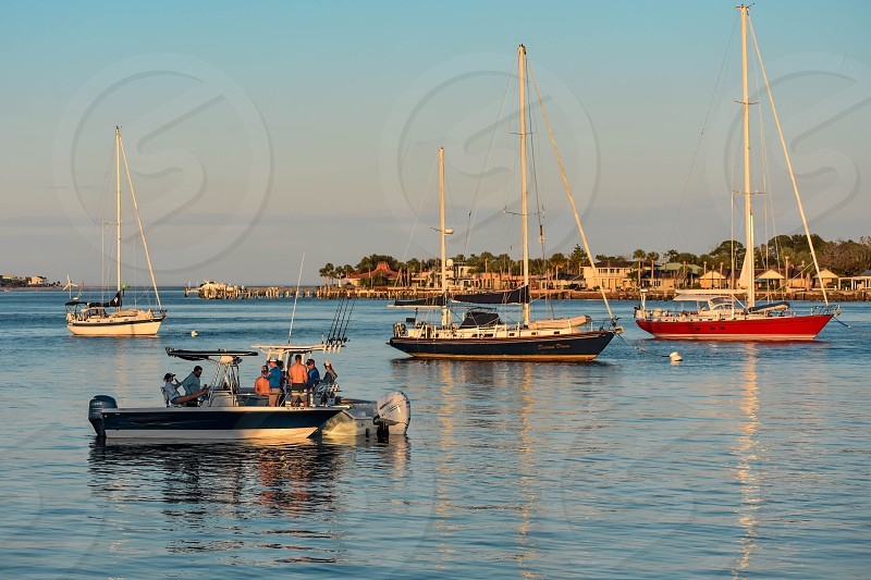 St. Augustine Florida. January 25  2019 . Sailboats on colorful sunset sky background in Florida's Historic Coast (2) photo